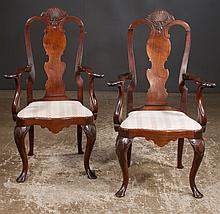 Pair of Queen Anne style mahogany armchairs with urn shaped shell carved backs, cabriole legs, shell carved knees, pad feet, 26