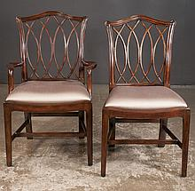 Set of ten Chippendale style mahogany dining chairs with interlaced backs on straight legs with canted corners and stretchers, armchair, 23