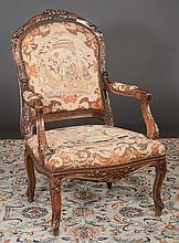 Louis XV carved walnut tapestry fauteuil with ribbon carved back, carved apron and carved cabriole legs, c.1880, 27