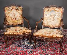 Pair of Louis XV walnut tapestry fauteuils with carved back crest, carved arms and carved aprons, c.1890, 29