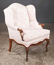 Louis XV style wing chair with carved apron and carved cabriole legs, 28