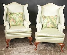 Pair of Queen Anne style walnut wing chairs with shaped wings, cabriole legs, shell carved knees and pad feet, 30