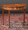Inlaid Sheraton style mahogany demilune game table on square tapered legs with spade feet, by