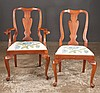 Set of eight queen Anne style mahogany dining chairs with urn shape backs, crewel work slip seats, cabriole legs and pad feet, by