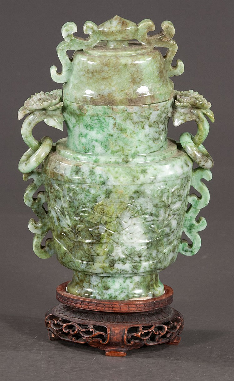 Green 19th century Chinese jade urn with pierced ring handles and wooden stand, 8