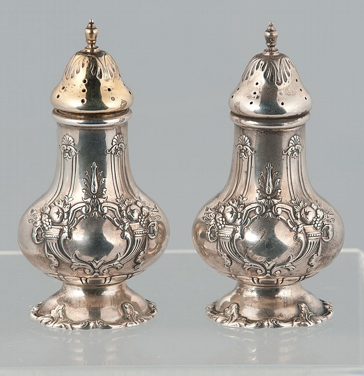 Pair of Reed & Barton sterling silver salt and pepper shakers in the