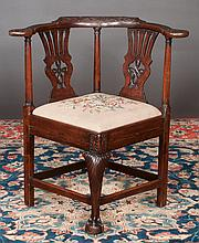 Chippendale style mahogany corner chair with carved back rail, pierced carved back, cabriole leg with carved knee and ball and claw foot, c.1860, 30
