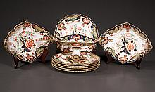 Royal Crown Derby dessert set with an oval compote, six plates and two oval serving dishes all with cobalt blue, green and bittersweet floral decoration, c.1920