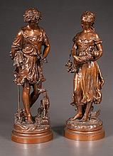 Pair of 19th century French spelter figures of a man holding a sheaf of wheat and a woman holding a child, signed