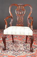 Irish Chippendale style mahogany armchair with pierced carved back, shaped arms, cabriole legs with carved knees and dolphin feet, c.1890-1900, 26