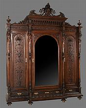Exceptional Louis XVI walnut armoire with scroll and mask carved pediment, carved corners with four carved figures of women, two carved panel doors and carved base, c.1890, 88