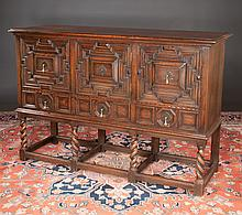 Jacobean style oak dresser base with three moulded doors over three drawers and on barley twist legs with stretchers, c.1890, 60