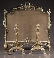 Pair of brass andirons with fluted columns and claw feet, 18