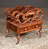English rosewood Canterbury with carved and shaped dividers, one drawer and turned legs with casters, c.1890, 21