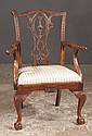 Chippendale mahogany armchair with scroll carved back, shell carved apron, carved cabriole legs and ball and claw feet, c.1890, 24