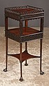 Three tier Queen Anne mahogany side table with pierced fret work gallery, blind fret carving on the sides and pad feet, c.1900