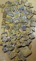 Ensemble de carreaux fragmentés En céramique peinte en polychromie sous glaçure opaque et à ligne noire, à décor floral et de palmipèdes sur fond jaune. Fragments de bordures à décor de fer de lance bleu, blanc et jaune. Iran, art Safavide, XVIIe