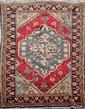 Ancien tapis CESAREE (Turquie) sur fond rouge cerise à médaillon central floral 1ère partie du XXème siècle 190 x 119 cm