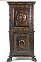 MEUBLE DE MARIAGE d'entre-deux en bois mouluré et sculpté formant secrétaire en partie haute, ouvrant par un abattant en façade et un vantail en partie basse. Il est orné d'un blason central et repose sur deux pieds griffes antérieurs. XVIIème siècle