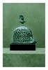 égypte, époque Copte.  BRULE PARFUMS. Bronze patine croûteuse éruptive. Au sommet un oiseau mangeant un serpent.  Manques à la base.  H. 19 cm