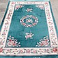CARPET: HAND-KNOTTED SCULPTURED CHINESE FLORAL - Wool on a cotton warp with teal field, central floral medallion, floral design corn...