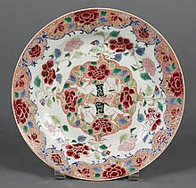 CHINESE PORCELAIN FAMILLE ROSE PLATE WITH TWO BOYS - Bowl floor painting portrays two reclining boys against a background of assorte...