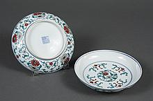 PAIR CHINESE PORCELAIN DOUCAI DISHES - In a traditional design of stylized flowers and colors on the floor and