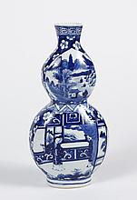 B/W CHINESE PORCELAIN DOUBLE GOURD VASE - Having reserves with figures and landscape scenes. 4-character mark to base. Condition goo...