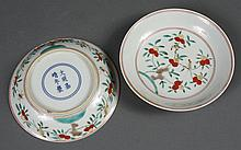 PAIR OF CHINESE PORCELAIN SANCAI SAUCERS - Decorated in the traditional three glaze design portraying song birds, small fruit and in...