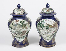 PAIR OF CHINESE PORCELAIN LIDDED JARS OR POTICHES - Decorated with reserves of landscape scenes with figures performing everyday act...