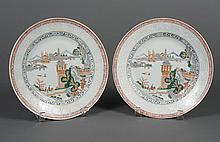 PAIR CHINESE PORCELAIN PLATES - Decorated with landscape elements to include architecture, trees and mountains. Several figures are...