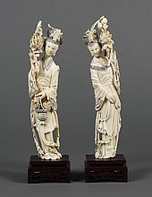 TWO CHINESE CARVED IVORY QUAN YIN FIGURES - Each with a Phoenix headdress and holding a lotus branch. One figure (10.25