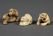 THREE CARVED IVORY NETSUKE MONKEYS - Shows one monkey clutching a turtle, another lounging with his arm on his knee, the third monke...