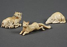 THREE CARVED IVORY NETSUKE - Includes a horned deer with an odd looking fawn, and a water buffalo (both of these are signed). Also a...
