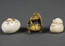 THREE CARVED IVORY NETSUKE - One includes three frogs carved in a leap-frog configuration, a turtle with a smaller turtle on its bac...