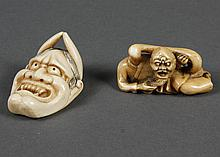 TWO CARVED IVORY ITEMS - One, a demon mask (amulet), shows horns that point toward the forehead and sharp