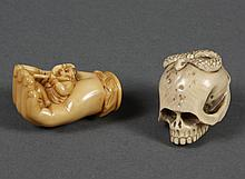 TWO CARVED IVORY NETSUKE - Includes a skull with a snake curled on the cranium; unsigned. Also, a gloved hand with an incubus or sma...