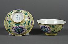 PAIR CHINESE PORCELAIN FAMILLE JAUNE BOWLS - Exterior wall decorated with peony blossoms and leafy fronds against a yellow ground. C...