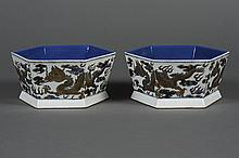 PAIR CHINESE PORCELAIN HEXAGONAL BOWLS - Decorated with three gold accented dragons, fire symbols and clouds on the exterior; having...