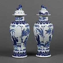 PAIR CHINESE PORCELAIN B/W VASES W/LIDS - Gallipot form showing a garden setting with lush vegetation, two women in robes with a fly...