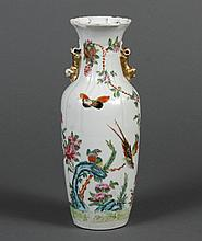 CHINESE PORCELAIN FAMILLE ROSE VASE - Paneled form decorated with exotic birds, flowers, trailing vines and butterflies. Rudimentary...