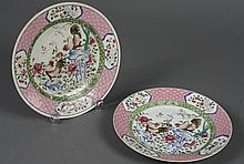 PAIR OF CHINESE PORCELAIN PLATES WITH ROOSTERS - Showing two roosters each on a rock amidst peonies and vines. Apparently unmarked....