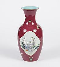 LARGE CHINESE PORCELAIN VASE - Rouleau shape having a fuschia ground with reserves of an Immortal and his acolyte. Enamel polychrome...