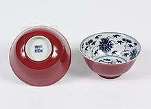 PAIR CHINESE PORCELAIN BOWLS WITH B/W INTERIOR - Having an ox-blood exterior and B/W interior with a stylized lotus blossom design....