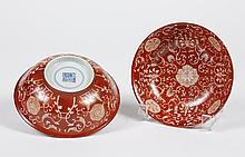 PAIR CHINESE PORCELAIN CORAL RED BOWLS - With an all over stylized foliate design of blossoms and tendrils drawn in the glaze to rev...