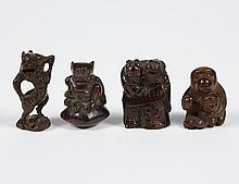 THREE CARVED IVORY NETSUKE AND A DRAGON FIGURE - Likely ivory; all darkly stained. Includes the following netsukes; a peasant couple...