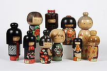 COLLECTION OF JAPANESE KOKESHI DOLLS - Handmade of wood with a simple trunk and enlarged head; minimal definition of the face. These...