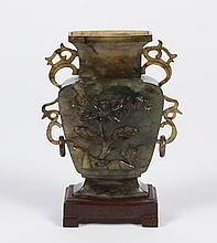CHINESE CARVED JADE VASE - Mottled dark green jade with a flower blossom and butterfly carved on one side and bamboo stalks on the v...