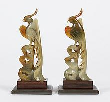 PAIR CARVED JADE PHOENIX - Having a crest and long plumed tail; resting on a wood stand with metal base. Apparently unsigned. Condi...