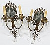 PAIR OF ANTIQUE BRASS AND CRYSTAL WALL SCONCES - One of two pair. Two arms with starburst cut mirror backs, crystal swags and prisms...